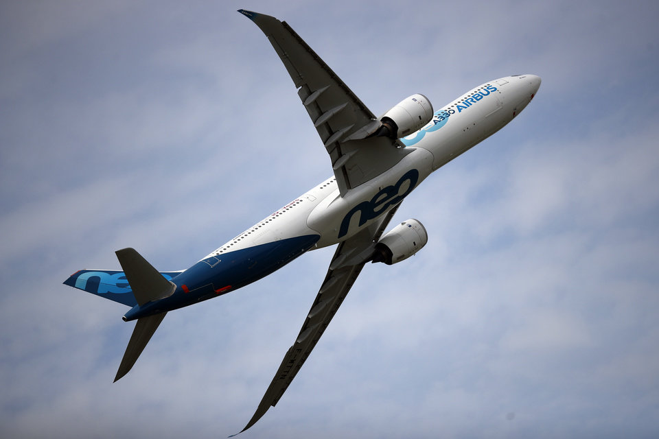 Photo -  FILE - In this June 18, 2019 file photo, an Airbus A330 performs a demonstration flight at Paris Air Show, in Le Bourget, north east of Paris. European plane maker Airbus lost 1.1 billion euros ($1.3 billion) amid an unprecedented global slump in air travel because of the pandemic, but expects to deliver hundreds of planes and make a profit this year. (AP Photo/ Francois Mori, File)