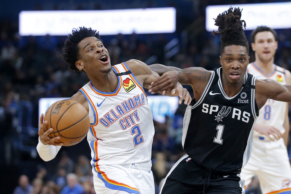 Photo - Oklahoma City's Shai Gilgeous-Alexander (2) is fouled by San Antonio's Lonnie Walker IV (1) during an NBA basketball game between the Oklahoma City Thunder and the San Antonio Spurs at Chesapeake Energy Arena in Oklahoma City, Tuesday, Feb. 11, 2020. [Bryan Terry/The Oklahoman]