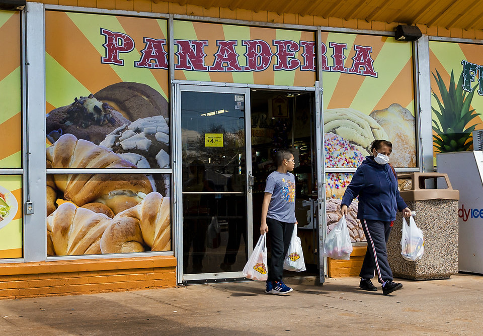 Photo - Customers leave the La Michoacana Meat Market on SW 29th St. in Oklahoma City, Okla. on Tuesday, March 31, 2020. [Chris Landsberger/The Oklahoman]