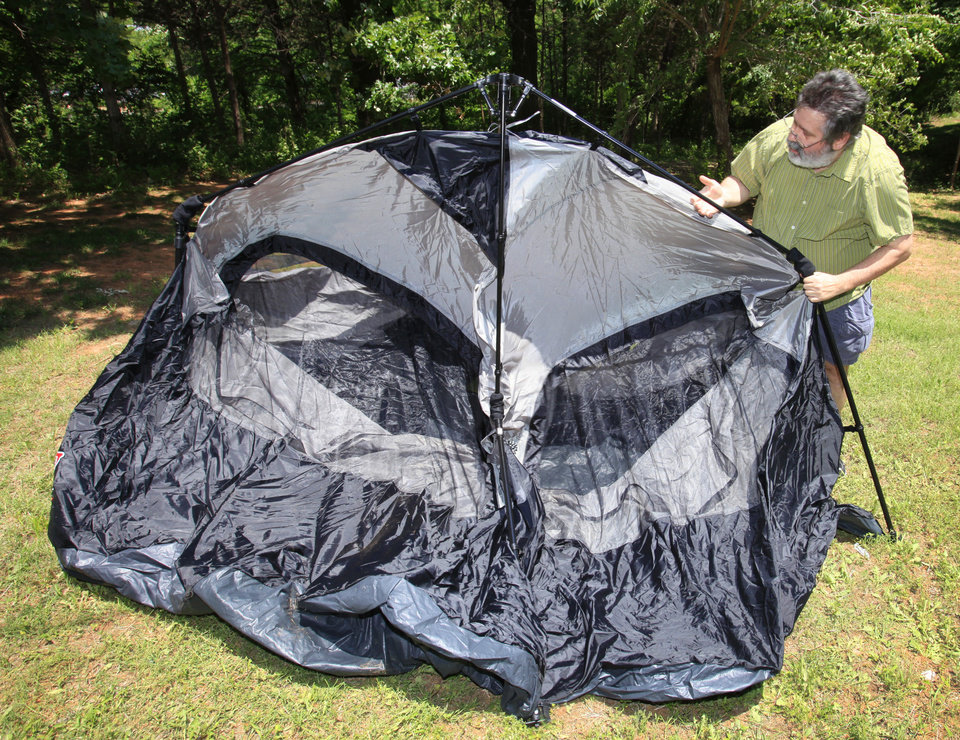 Outdoors Editor Ed Godfrey trying to put up a c&ing tent in one minute or less Thursday June 2 2011. Photo by David McDaniel The Oklahoman ORG XMIT ... & Ed Godfrey becomes a pitch man to put his tent skills to the test ...