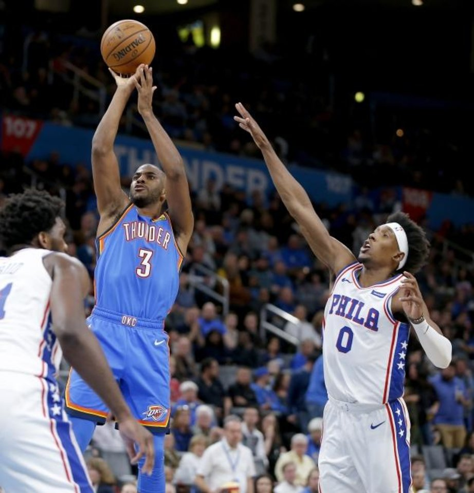 Photo -  Oklahoma City's Chris Paul (3) shoots a basket beside Philadelphia's Josh Richardson (0) during Friday's game at Chesapeake Arena. [Bryan Terry/The Oklahoman]
