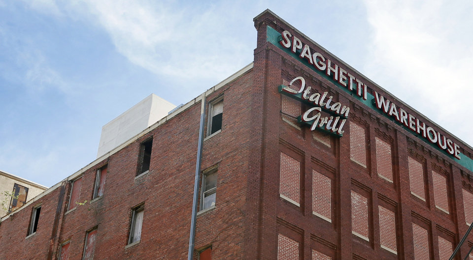 Photo -  Open windows can be seen Wednesday afternoon on the side of the building that was home to Spaghetti Warehouse in Bricktown.