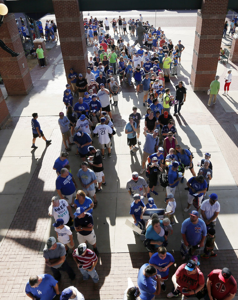Photo -  Fans wait to enter Chickasaw Bricktown Ballpark before the Oklahoma City Dodgers take on Omaha on Saturday in a rehab start for Los Angeles pitcher Clayton Kershaw. [PHOTO BY NATE BILLINGS, THE OKLAHOMAN]