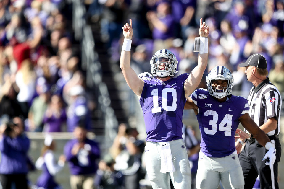 Photo - Kansas State quarterback Skylar Thompson (10) and running back James Gilbert (34) celebrate Thompson's touchdown against Oklahoma during NCAA football game at Bill Snyder Family Stadium in Manhattan, Kan., Saturday, Oct. 26, 2019. (Ian Maule/Tulsa World via AP)