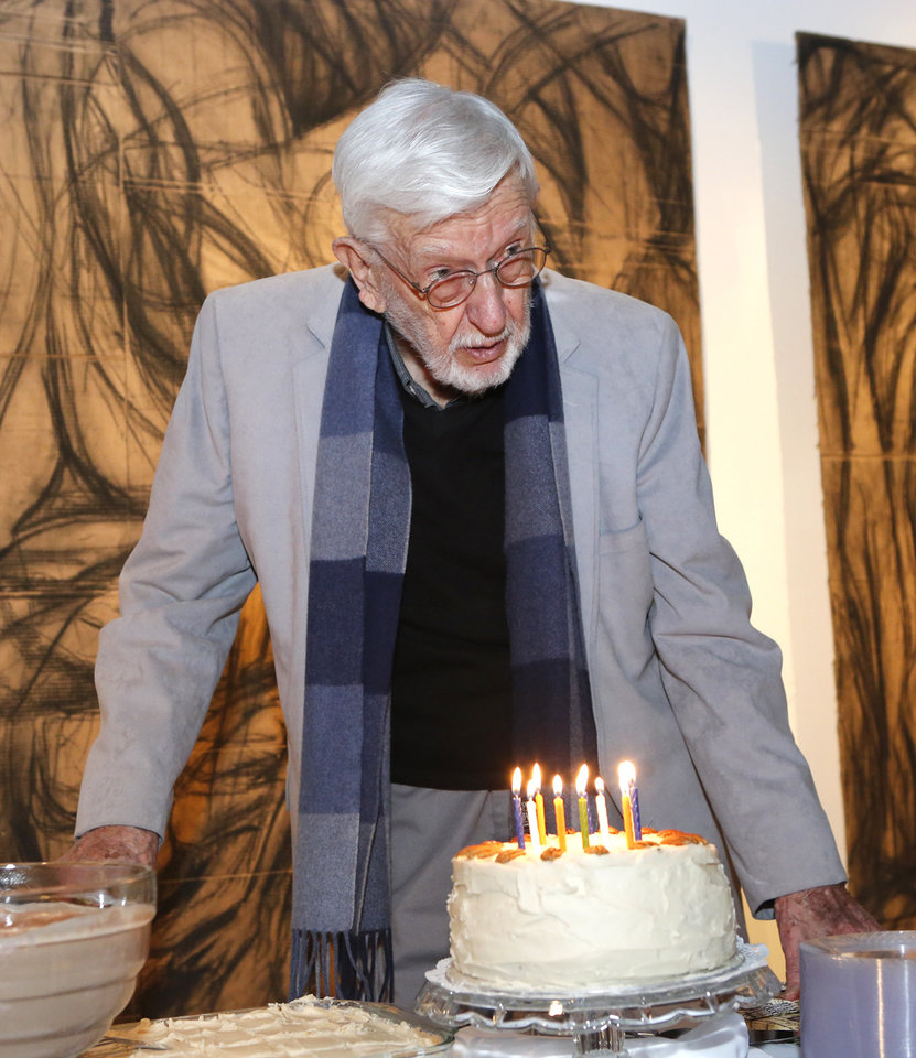 Oklahoma Christian University music professor Harold Fletcher, 91, prepares  to blow out the candles on his birthday cake Thursday. Photo by David  McDaniel, ...
