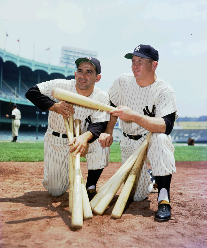 Photo - New York Yankees baseball player Mickey Mantle, left, and Yogi Berra pose in this 1956 file photo. (AP Photo/file)