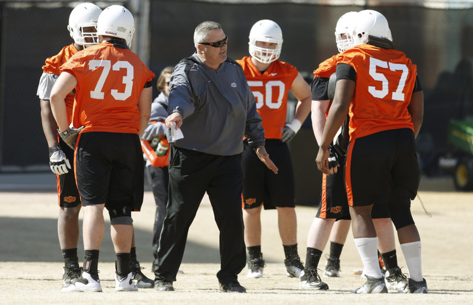 Photo - OKLAHOMA STATE UNIVERSITY / OSU / COLLEGE FOOTBALL: Oklahoma State coach Joe Wickline works with the offensive line during an OSU spring football practice in Stillwater, Okla., Wednesday, March 13, 2013. Photo by Bryan Terry, The Oklahoman