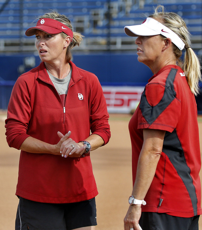 Photo -  OU pitching coach Melyssa Lombardi, left, talks with head coach Patty Gasso during practice for the Women's College World Series at Hall of Fame Stadium in Oklahoma City on Wednesday. [PHOTO BY CHRIS LANDSBERGER, THE OKLAHOMAN]