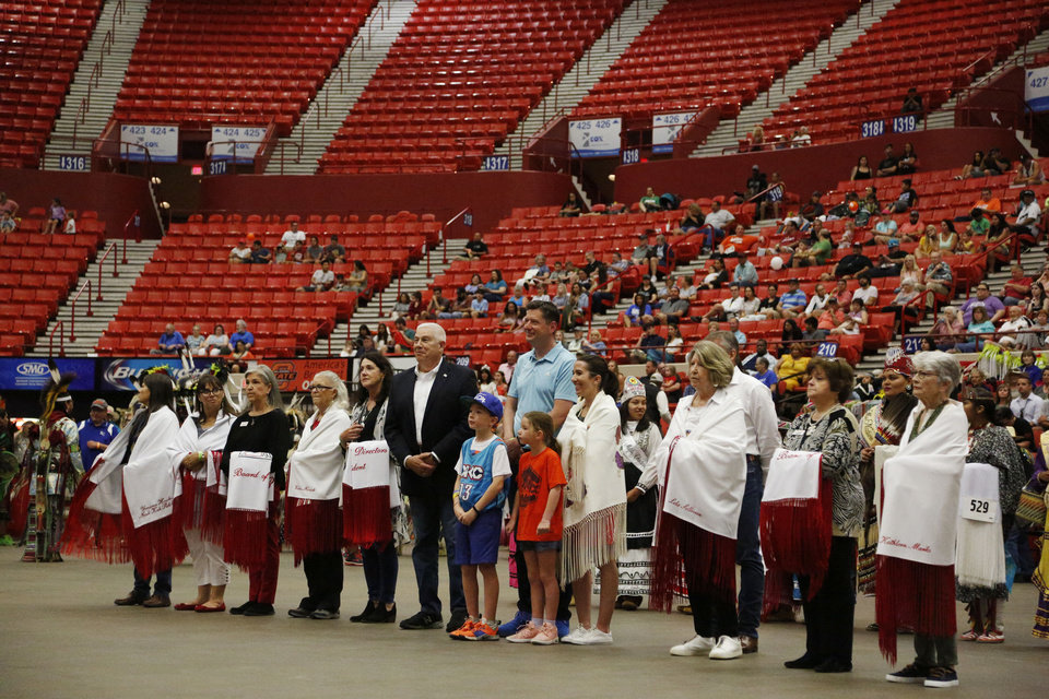 Photo - Mayor Holt with members of the Red Festival Board of Directors at the 2019 Red Earth Festival at the Cox Convention Center in Oklahoma City, Oklahoma Saturday, June 8, 2019.  [Paxson Haws/The Oklahoman]