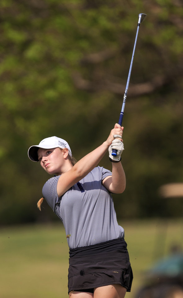 Washington girls golf in contention kingfishers maddi kamas hits her approach shot during the class 3a girls golf state tournament at westwood park golf course in norman on wednesday ccuart Choice Image