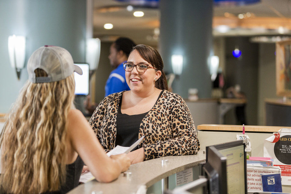 Photo -  Becky Hankins, a senior academic adviser, helps a student at the Tulsa Community College Metro Campus.