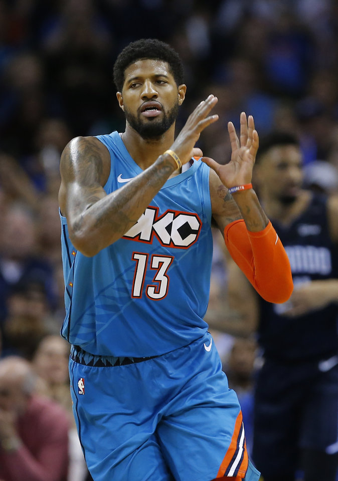 Photo - Oklahoma City's Paul George (13) celebrates during the NBA game between the Oklahoma City Thunder and the Orlando Magic at the Chesapeake Energy Arena  Tuesday, Feb. 5, 2019. Photo by Sarah Phipps, The Oklahoman