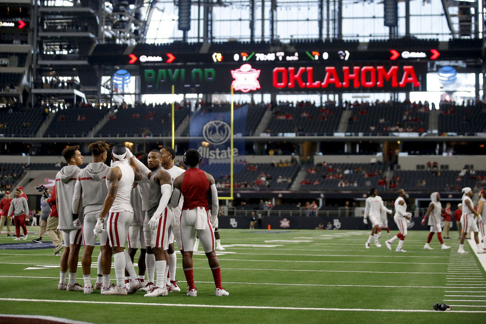 Photo - Oklahoma players gather on the field before the Big 12 Championship Game between the University of Oklahoma Sooners (OU) and the Baylor University Bears at AT&T Stadium in Arlington, Texas, Saturday, Dec. 7, 2019. [Bryan Terry/The Oklahoman]