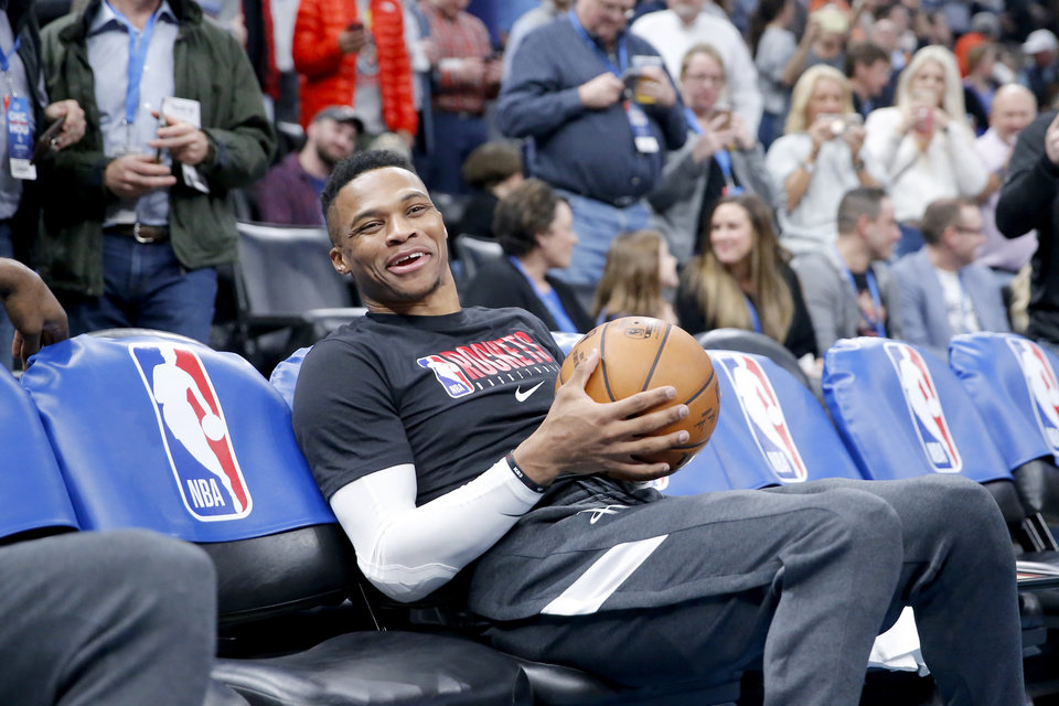Photo - Houston's Russell Westbrook (0) sits on the bench before an NBA basketball game between the Oklahoma City Thunder and Houston Rockets at Chesapeake Energy Arena in Oklahoma City, Thursday, Jan. 9, 2020. [Sarah Phipps/The Oklahoman]