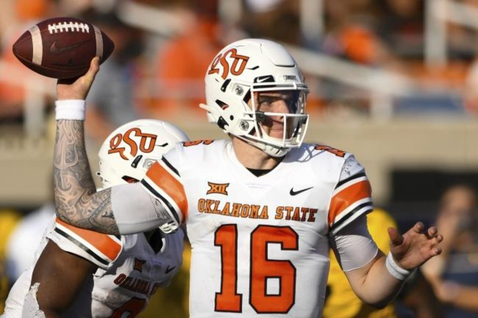 Photo -  OSU freshman quarterback Shane Illingworth is 19-of-26 passing for 219 yards in just over five quarters of action. [AP Photo/Brody Schmidt]
