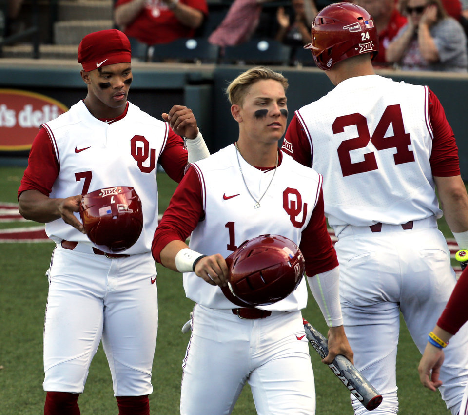 Oklahoma s Kyler Murray (7) and Steele Walker (1) are greeted after scoring a4f646ff5