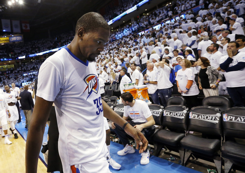 Photo - Oklahoma City's Kevin Durant (35) leaves the court after Game 2 of the first round series between the Oklahoma City Thunder and the Dallas Mavericks in the NBA playoffs at Chesapeake Energy Arena in Oklahoma City, Monday, April 18, 2016. Dallas won 85-84. Photo by Nate Billings, The Oklahoman