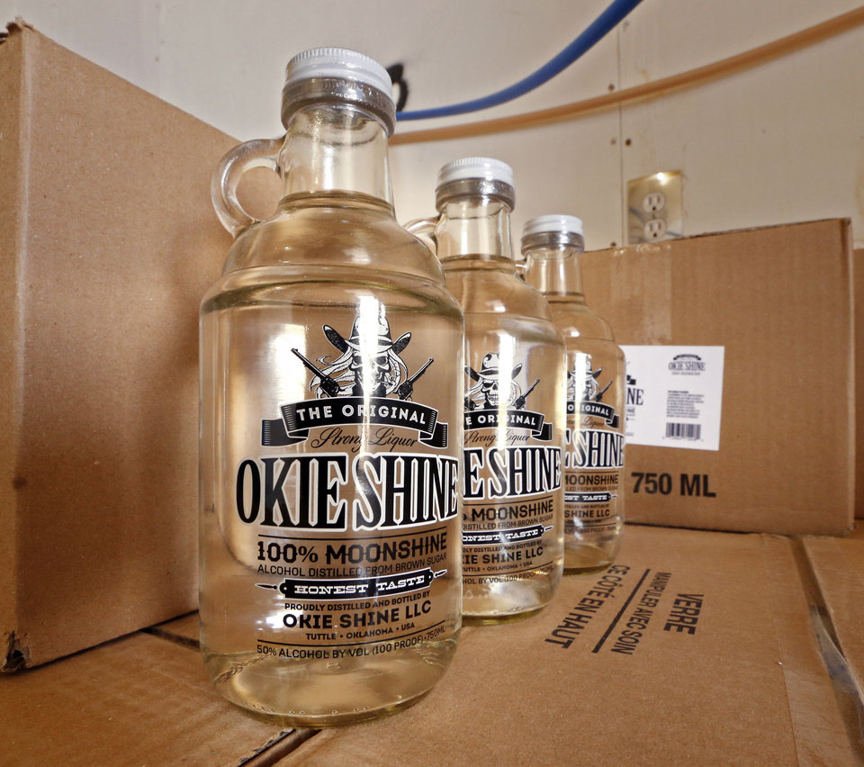 Photo -  Okie Shine is produced by Ricky and Georgia Sowers in Tuttle. They say their distillery is the first legal moonshine plant in the state. [Photo by Steve Sisney, The Oklahoman]