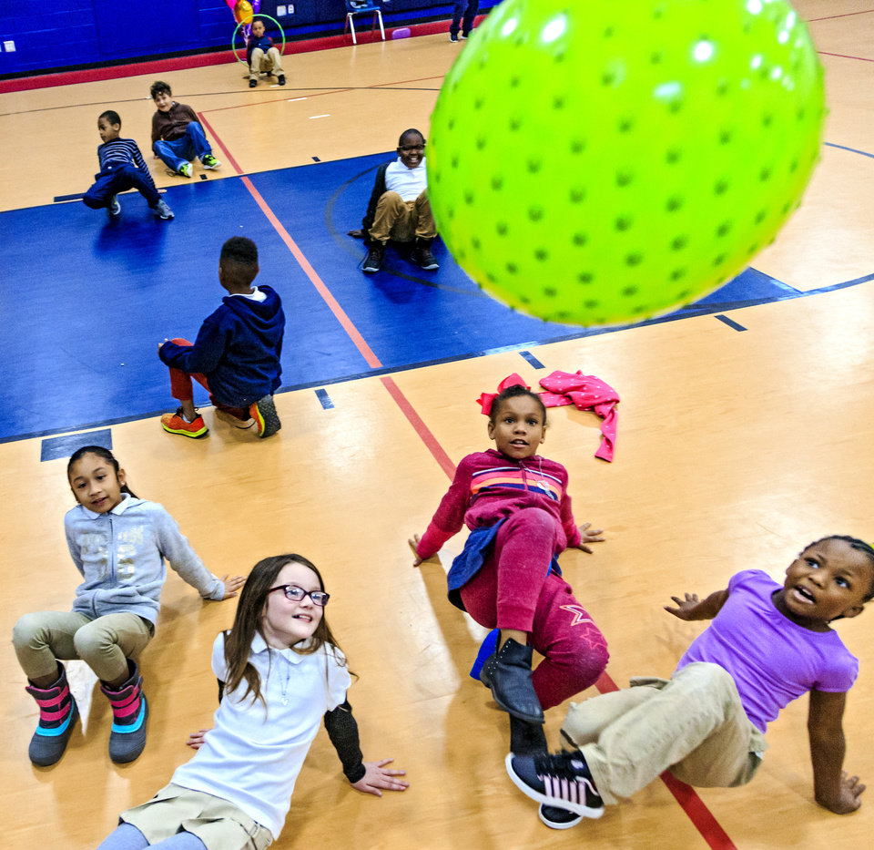 Photo - Edward Elementary second grade students  play crab kickball during the celebration of the classes achievements for the Wiggle Out Loud activity challenge at Edward Elementary School in Oklahoma City, Okla. on Friday, March 1, 2019. Photo by Chris Landsberger, The Oklahoman