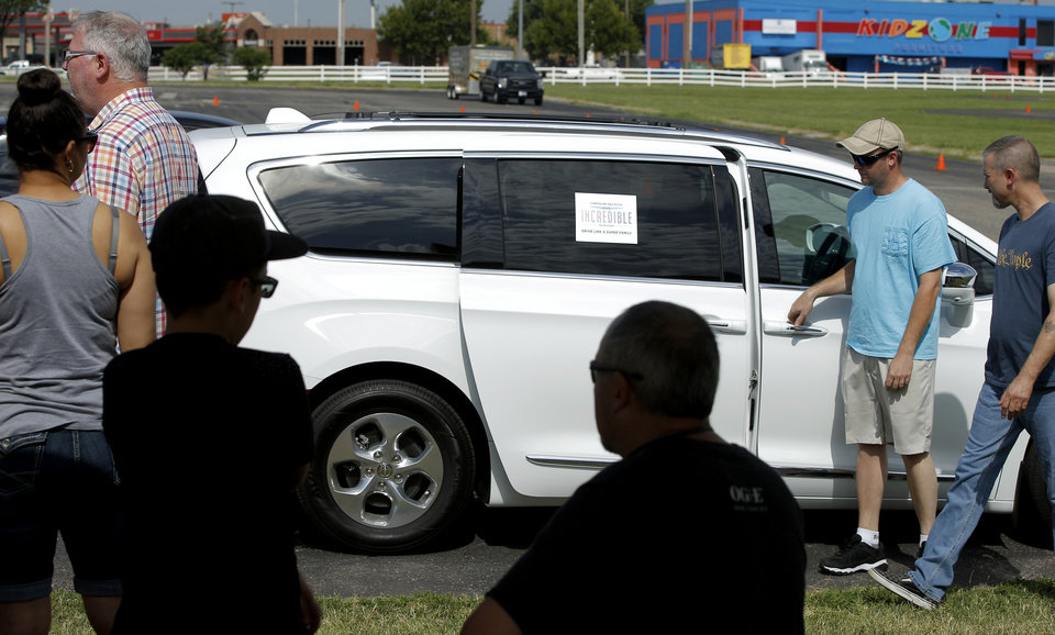 Photo -  People board a hybrid Chrysler Pacifica for a test drive at OG&E's Ride and Drive event.
