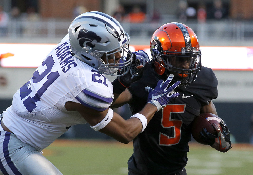 Photo - Oklahoma State's Justice Hill (5) gets by Kansas State's Kendall Adams (21) on the way to a touchdown in the third quarter during a college football game between the Oklahoma State Cowboys (OSU) and the Kansas Sate Wildcats (KSU) at Boone Pickens Stadium in Stillwater, Okla., Saturday, Nov. 18, 2017. Photo by Sarah Phipps, The Oklahoman