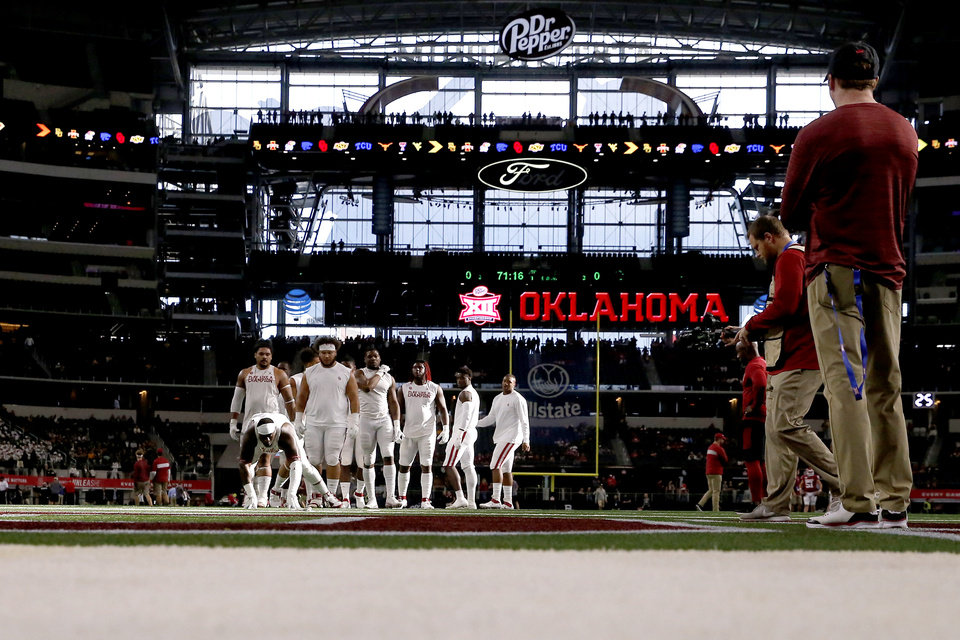 Photo - Oklahoma players warm up before the Big 12 Championship Game between the University of Oklahoma Sooners (OU) and the Baylor University Bears at AT&T Stadium in Arlington, Texas, Saturday, Dec. 7, 2019. [Bryan Terry/The Oklahoman]
