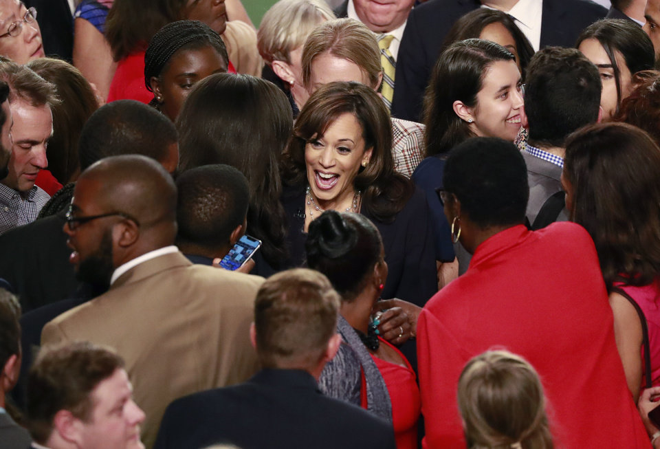 Photo - Democratic presidential candidate Sen. Kamala Harris, D-Calif., is surrounded by supporters after the Democratic primary debate hosted by NBC News at the Adrienne Arsht Center for the Performing Arts, Thursday, June 27, 2019, in Miami. (AP Photo/Wilfredo Lee)