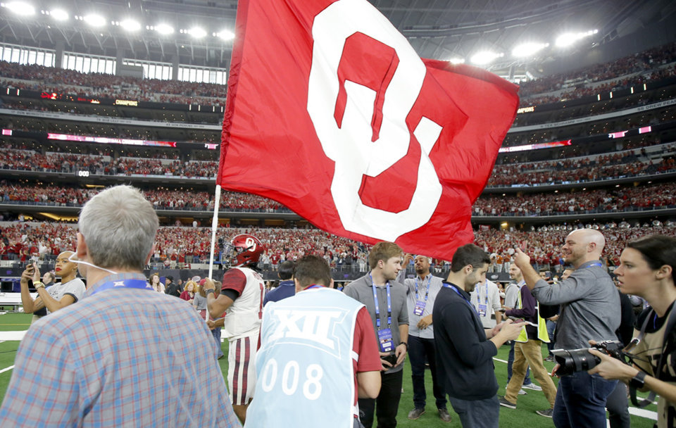Photo - Oklahoma's Kyler Murray (1) arries an Oklahoma flag after the Big 12 Championship football game between the Oklahoma Sooners (OU) and the Texas Longhorns (UT) at AT&T Stadium in Arlington, Texas, Saturday, Dec. 1, 2018.  Oklahoma won 39-27. Photo by Bryan Terry, The Oklahoman