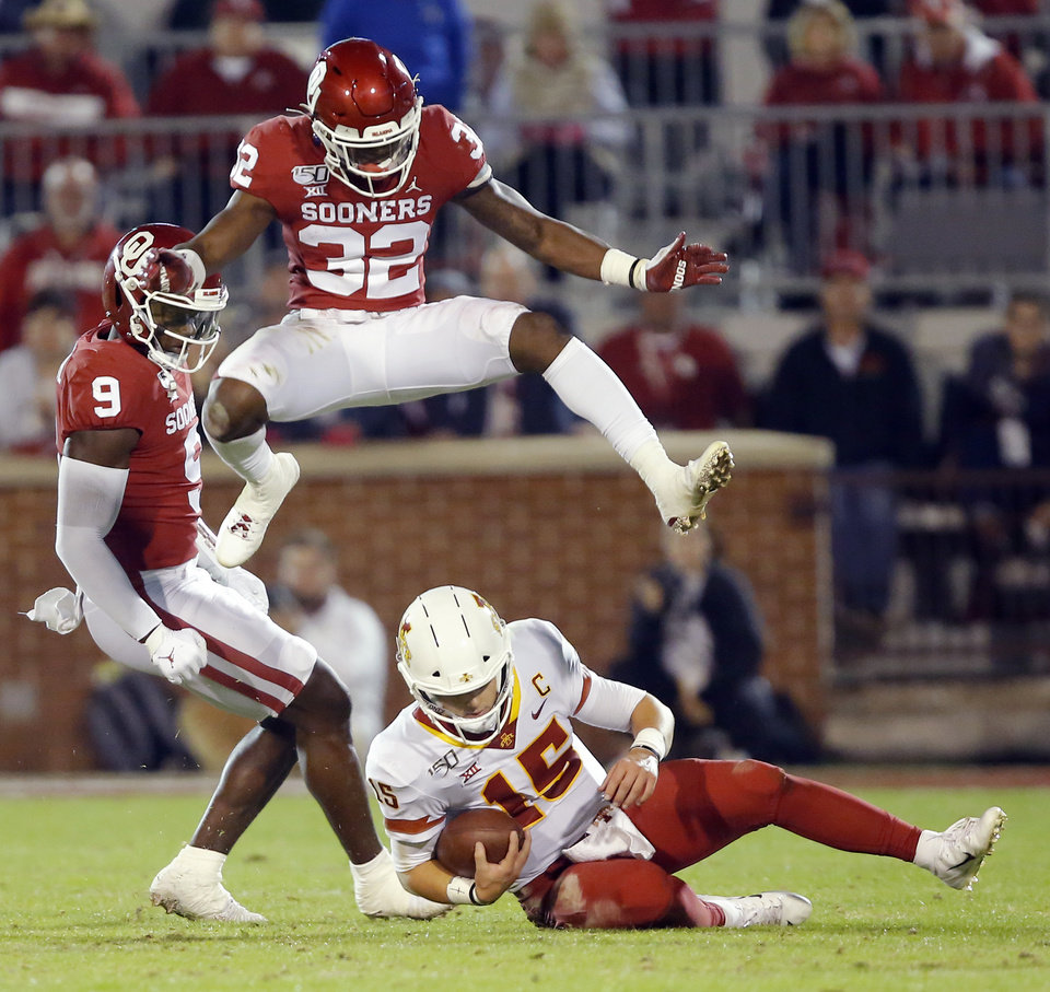 Photo - Oklahoma's Delarrin Turner-Yell (32) leaps over Iowa State's Brock Purdy (15) as he slides down during an NCAA football game between the University of Oklahoma Sooners (OU) and the Iowa State University Cyclones at Gaylord Family-Oklahoma Memorial Stadium in Norman, Okla., Saturday, Nov. 9, 2019. [Bryan Terry/The Oklahoman]