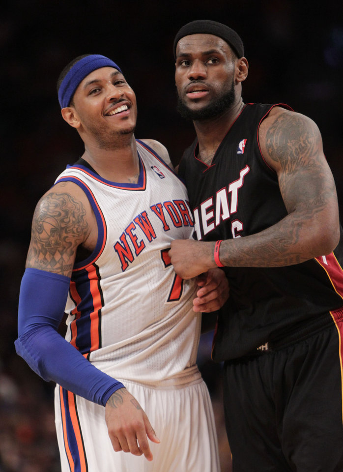 Photo -  Oklahoma City's Carmelo Anthony, left, then with the New York Knicks, and LeBron James have not let competition come between their friendship. [AP PHOTO]