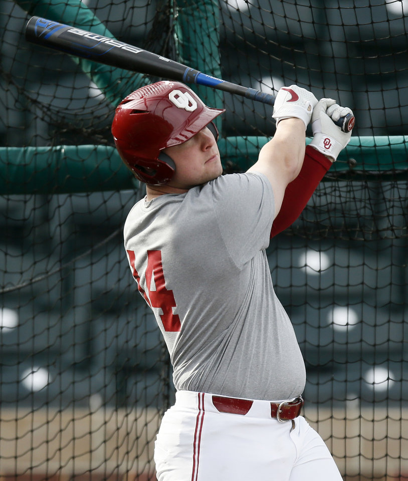 Photo - OU's Justin Mitchell (14) takes batting practice during practice for the University of Oklahoma baseball team at L. Dale Mitchell Park in Norman, Okla., Friday, Feb. 7, 2020. [Nate Billings/The Oklahoman]