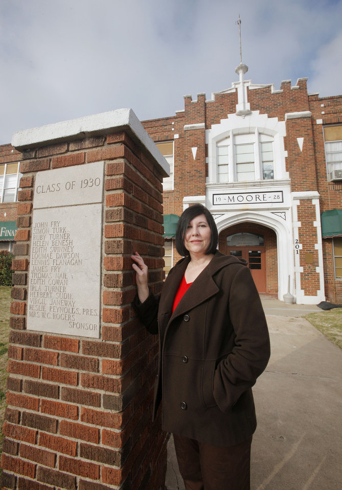 Photo - Janna Gruber, with Open Range Archaeology, stands in front of the 1928 Moore school building, which is on the National Register of Historic Places.  Photos by Paul B. Southerland, The Oklahoman