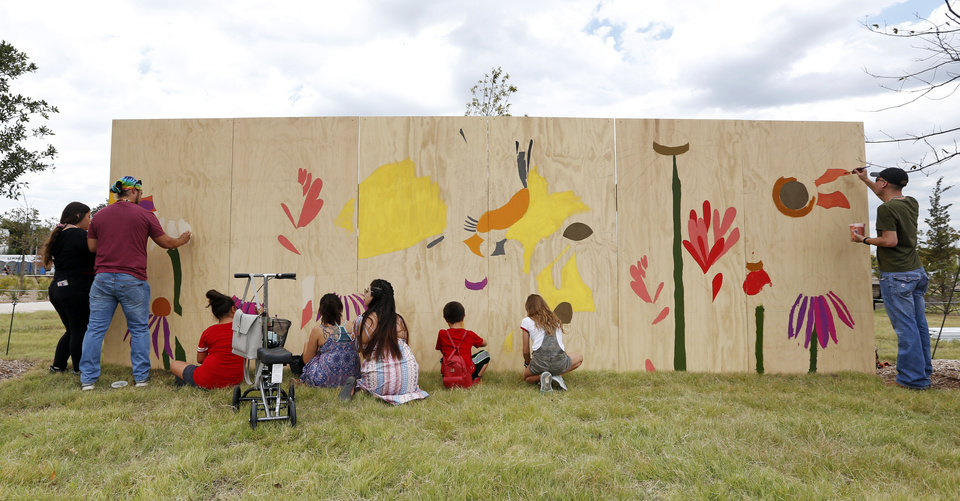 Photo - People paint a community mural during the grand opening weekend of Scissortail Park in Oklahoma City, Saturday, Sept. 28, 2019. [Nate Billings/The Oklahoman]