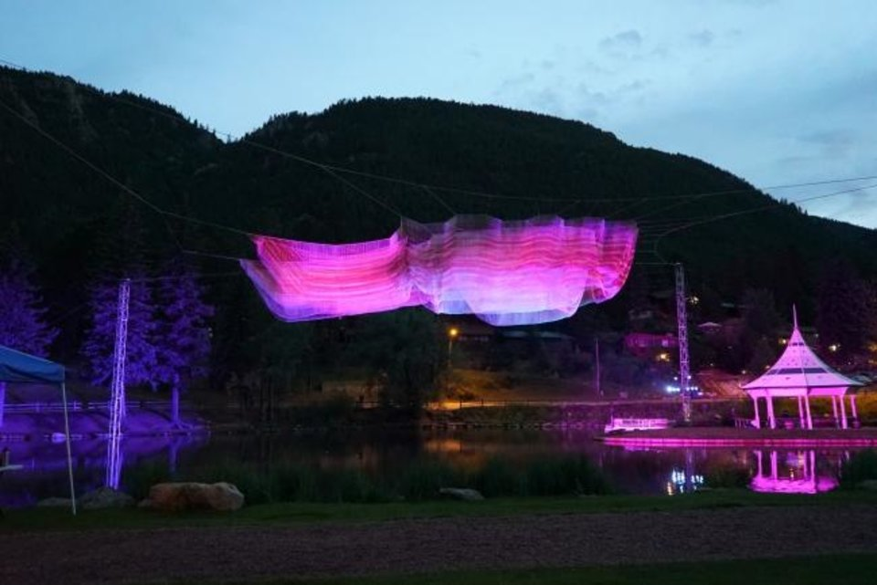 Photo -  This year's main exhibit, a massive 100- by 45-foot sculpture by artist Janet Echelman, hangs in midair over Gazebo Lake. [Photo provided.]