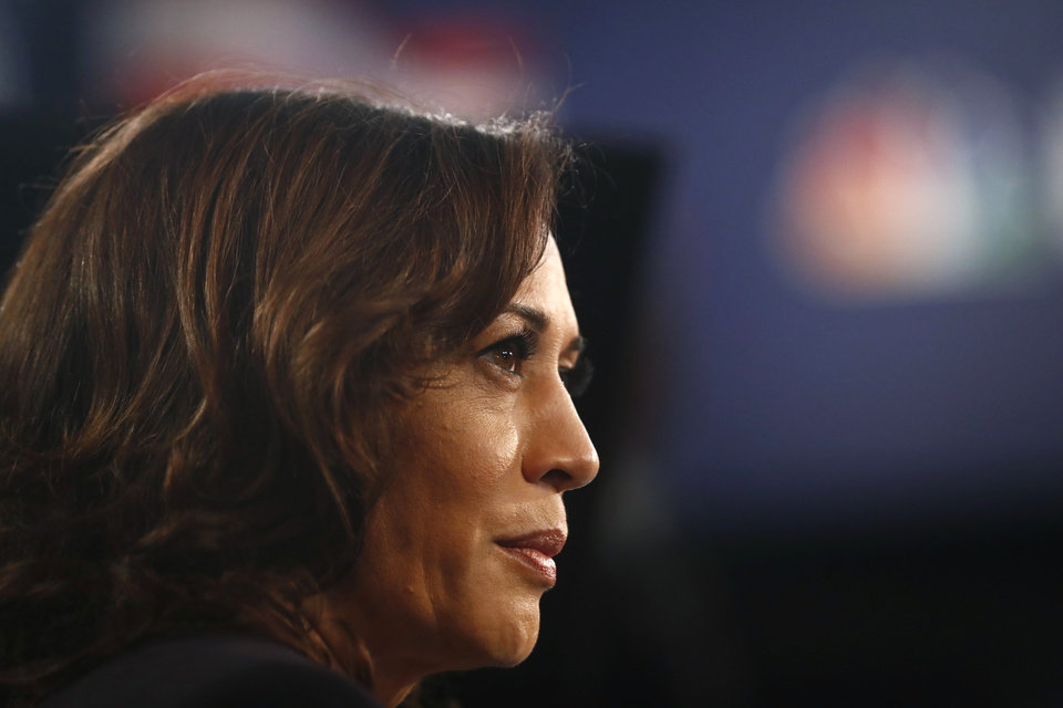 Photo - Democratic presidential candidate Sen. Kamala Harris, D-Calif., listens to questions in the spin room after the Democratic primary debate hosted by NBC News at the Adrienne Arsht Center for the Performing Art, Thursday, June 27, 2019, in Miami. (AP Photo/Brynn Anderson)