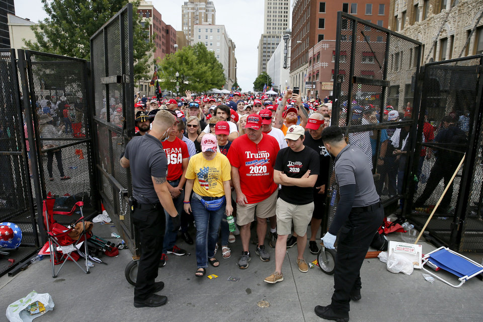Photo - President Donald Trump supporters are let inside a barricade before a rally at the BOK Center in Tulsa, Okla., Saturday, June 20, 2020. [Bryan Terry/The Oklahoman]