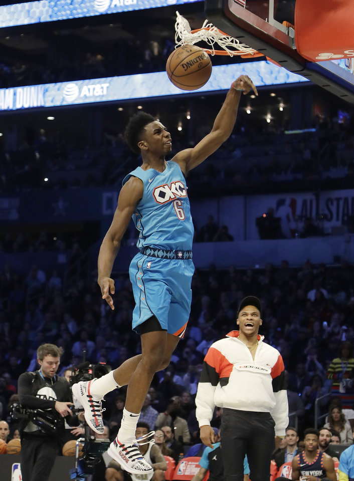 Photo - Oklahoma City Thunder Hamidou Diallo heads to the hoop during the NBA All-Star Slam Dunk contest, Saturday, Feb. 16, 2019, in Charlotte, N.C. (AP Photo/Chuck Burton)