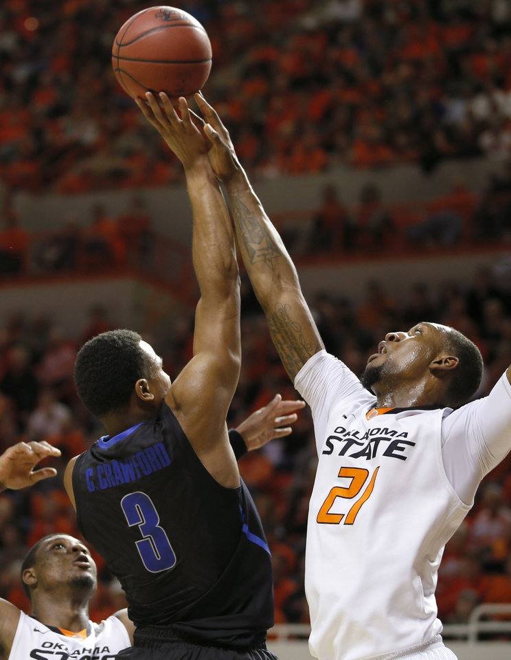 Photo - Oklahoma State's Kamari Murphy (21) blocks the shot of Memphis' Chris Crawford (3) during an NCAA college basketball game between Oklahoma State and Memphis at Gallagher-Iba Arena in Stillwater, Okla., Tuesday, Nov. 19, 2013. Photo by Bryan Terry, The Oklahoman