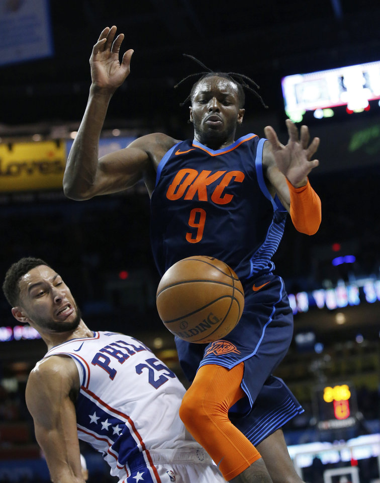 Photo - Oklahoma City Thunder forward Jerami Grant (9) and Philadelphia 76ers guard Ben Simmons (25) watch as the ball goes out of bounds during the second half of an NBA basketball game Thursday, Feb. 28, 2019, in Oklahoma City. (AP Photo/Sue Ogrocki)