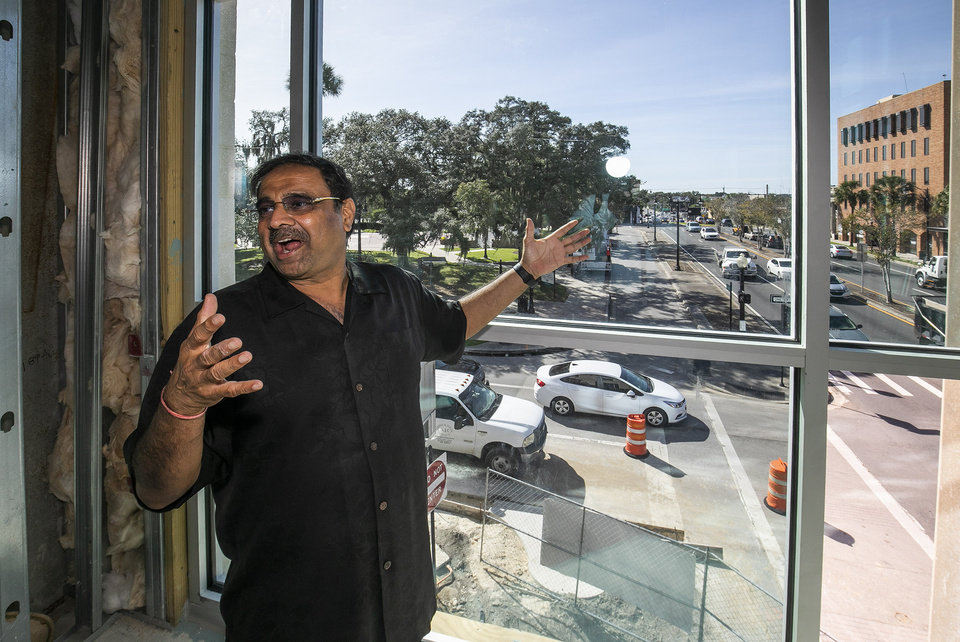 Photo -  FILE - In this Oct. 23, 2019 file photo, Developer Danny Gaekwad shows the view from the gym that overlooks the intersection of Silver Springs Blvd  in Ocala, Fla.  Since the coronavirus crisis started, hotel owners say they are struggling to get relief on a type of loan that Wall Street investors buy.  [Doug Engle/Ocala Star-Banner via AP)