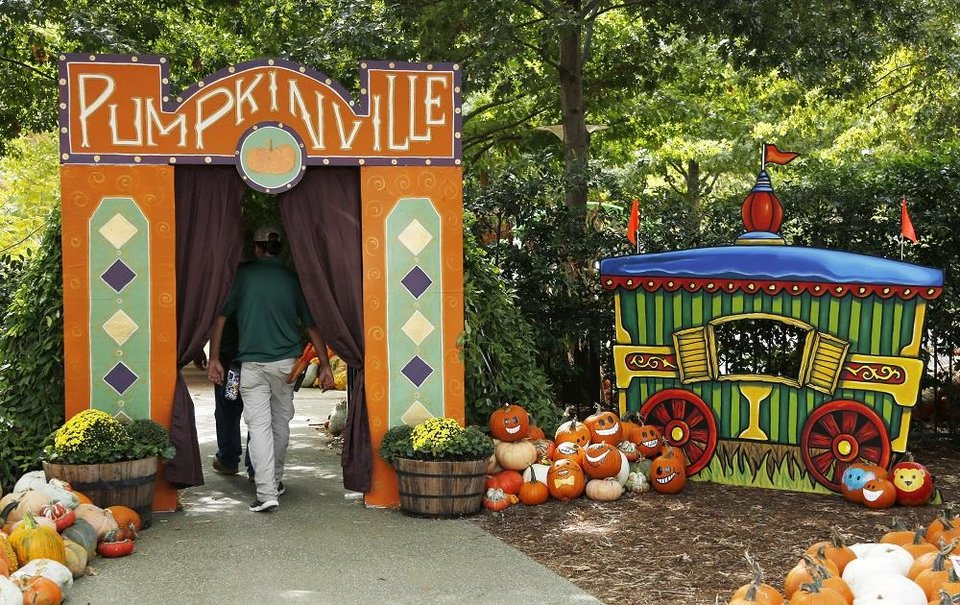 Photo - In keeping with this year's vintage carnival theme, local artist Nick Bayer created an old-fashioned train car for the entrance to Pumpkinville, which opens Friday. Setup for Pumpkinville in the Children's Garden at the Myriad Botanical Gardens continues Wednesday, October 9, 2019. [Doug Hoke/The Oklahoman]