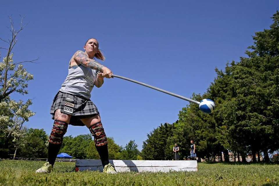 Photo - Kara Bonham of Fort Collins, Colo., throws a Scottish hammer during the Iron Thistle Scottish Festival in Yukon, Okla., Saturday, April 27, 2019. [Bryan Terry/The Oklahoman Archives]