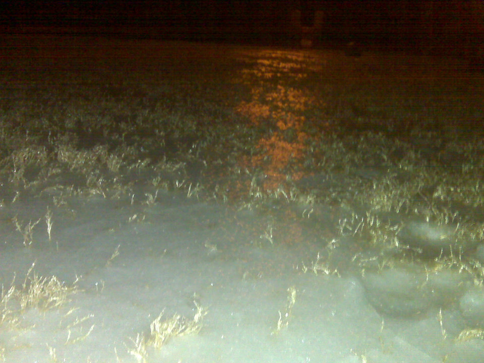Photo - Ice coats the ground in northwest Oklahoma City. Photo by Robert Medley