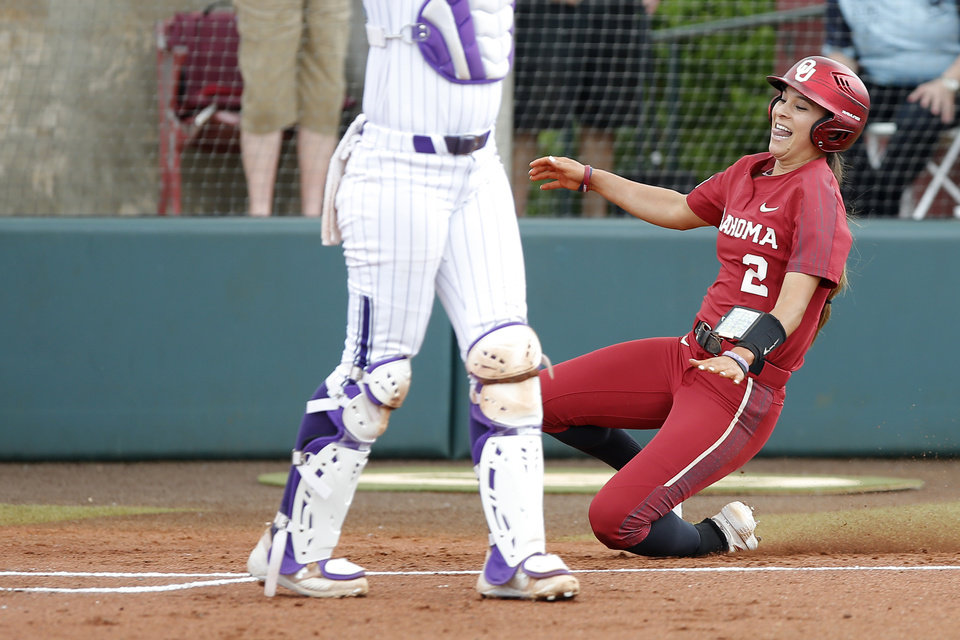 Photo - Oklahoma's Sydney Romero (2) slides home to score in the first inning of the second softball game in the Norman Super Regional between the University of Oklahoma (OU) and Northwestern in Norman, Okla., Saturday, May 25, 2019. Oklahoma won 8-0 to send them to the Women's College World Series. [Bryan Terry/The Oklahoman]