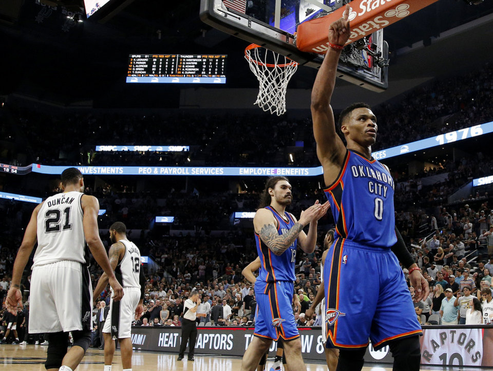 Photo - Oklahoma City's Russell Westbrook (0) celebrates after Game 5 of the second-round series between the Oklahoma City Thunder and the San Antonio Spurs in the NBA playoffs at the AT&T Center in San Antonio, Tuesday, May 10, 2016. Oklahoma City won 95-91. Photo by Bryan Terry, The Oklahoman
