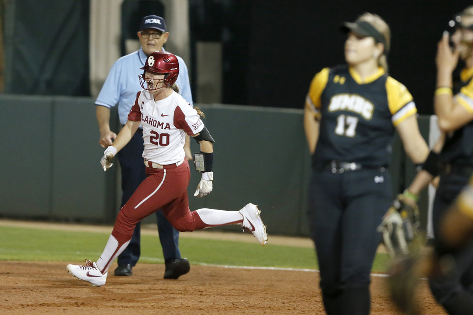 Photo - Oklahoma's Caleigh Clifton (20) celebrates after hitting a two-run home run in the third inning during the Norman Regional NCAA softball tournament game between the University of Oklahoma (OU) and UMBC in Norman, Okla., Friday, May 17, 2019. Oklahoma won 12-0.  [Bryan Terry/The Oklahoman]