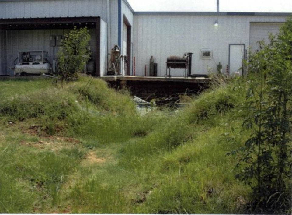 Photo -  A yard is seen behind Eagle Industries, 10901 SE 29 St., in Midwest City on Aug. 2, 2007. Trichloroethylene was illegally dumped in the yard, poisoning nearby groundwater. [Photo provided by Oklahoma Department of Environmental Quality]
