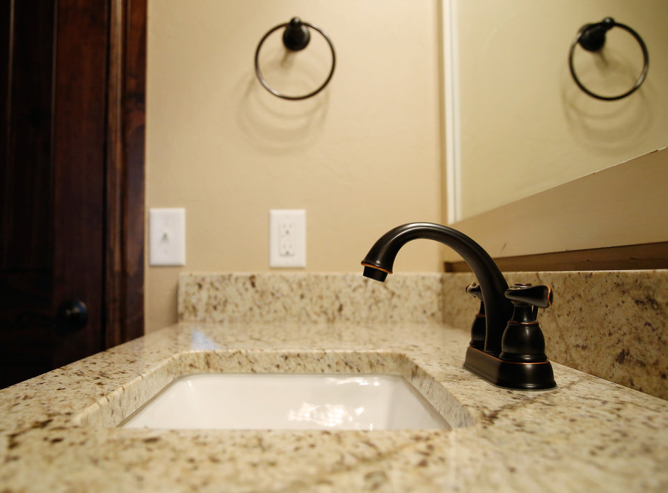 Epic Photo The faucet mirror and towel holder bine in this view to form an