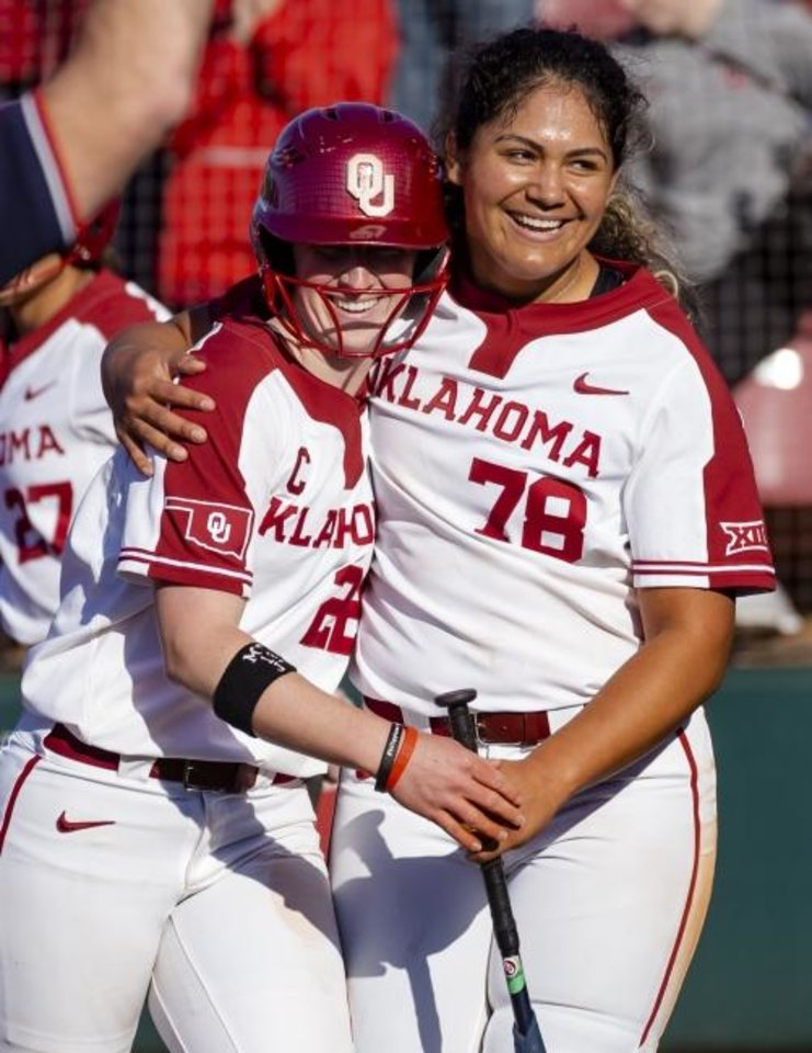 Photo -  OU's Lynnsie Elam (22) and Jocelyn All (78) celebrate Elam's homer during the Sooners' 8-3 win Friday against Northwestern at Marita Hynes Field in Norman. [Chris Landsberger/The Oklahoman]