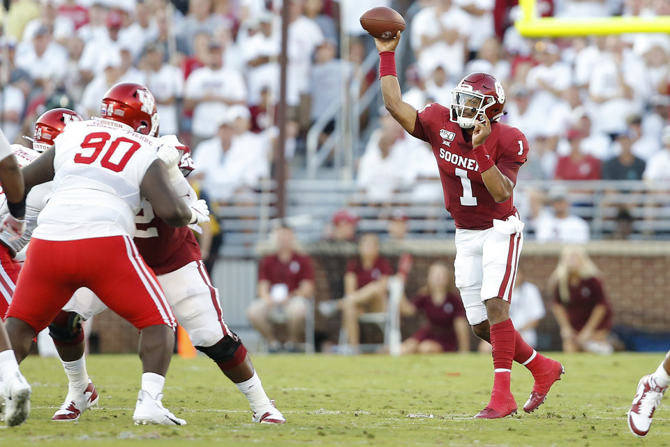 Photo - Oklahoma's Jalen Hurts (1) throws a pass during a college football game between the University of Oklahoma Sooners (OU) and the Houston Cougars at Gaylord Family-Oklahoma Memorial Stadium in Norman, Okla., Sunday, Sept. 1, 2019. [Bryan Terry/The Oklahoman]